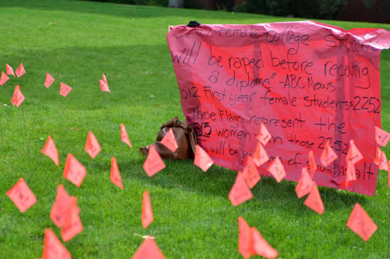Flags+planted+by+students+in+front+of+Stevens+represent+the+one+in+four+women+who+will+be+sexually+assaulted+during+their+college+career%2C+Thursday%2C+Sept.+5.