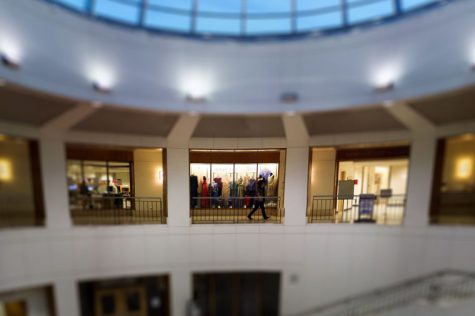 Timeless garments decorate hall of library atrium