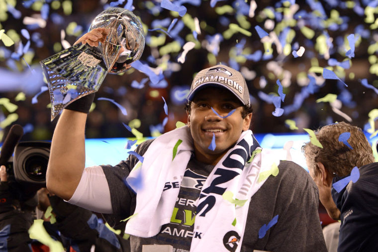 Russell Wilson Of The Seattle Seahawks Hoists Lombardi Trophy At End Super Bowl
