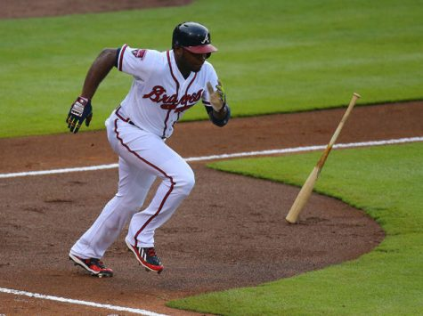 The Atlanta Braves' Justin Upton tries in vain to beat out a ground ball to Philadelphia Phillies' shortstop Jimmy Rollins during the first inning at Turner Field in Atlanta, June 17, 2014.