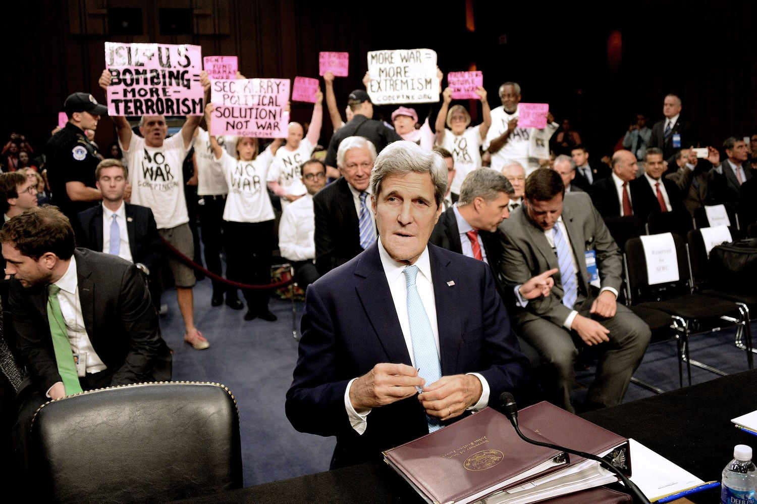 Code Pink for Peace members protest against U.S. military action in Iraq as Secretary of State John Kerry testifies at a Senate Foreign Relations Committee hearing on the United States strategy to defeat the Islamic State in Iraq and the Levant (ISIL) on Wednesday, Sept. 17, 2014, in Washington, D.C. (Olivier Douliery/Abaca Press/MCT)