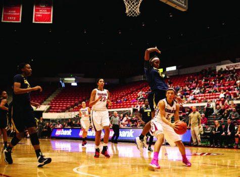 Senior guard Tia Presley looks towards the basket against the California Bears on Sunday, Feb. 9, 2014 in Beasley Coliseum.