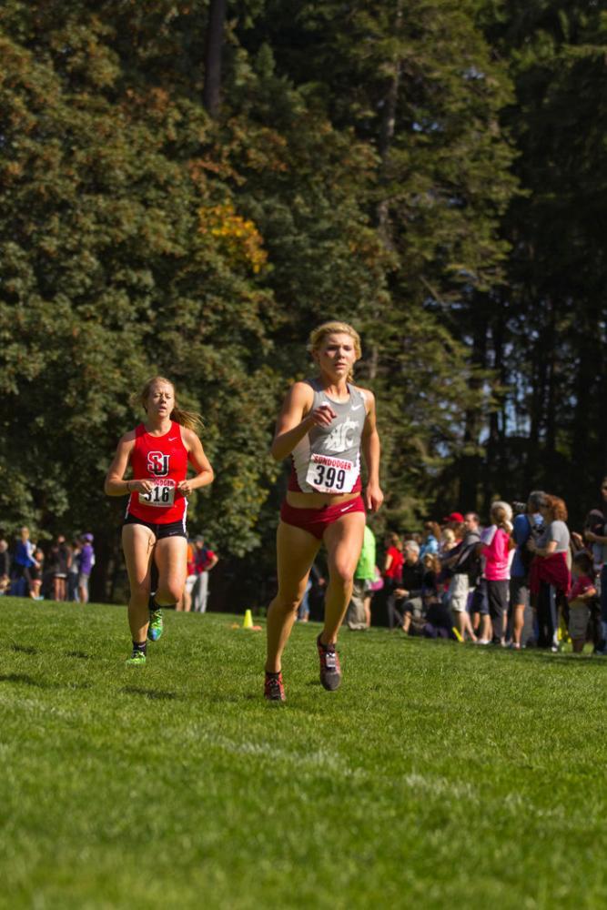 Junior Steffie Pavey pulls ahead of a Seattle University runner during the Sundodger Invitational in Seattle, Sept. 20, 2014.