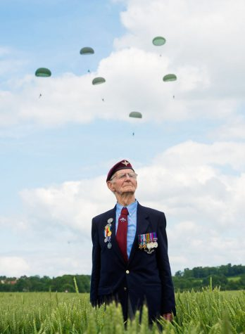 Members of the military risk much more than their lives and should be remembered and thanked for their service. Fred Glover, 88, a veteran of the 9th Para Battalion, waits to watch a parachute jump just outside Rainville during D-Day commemorations on June 5, 2014 in Ranville, France.