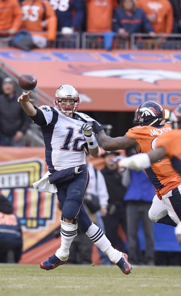 Patriots' Tom Brady rushed by Broncos' Malik Jackson.