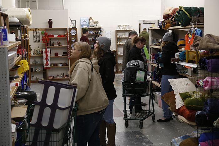 Customers browse through shelves supplies.