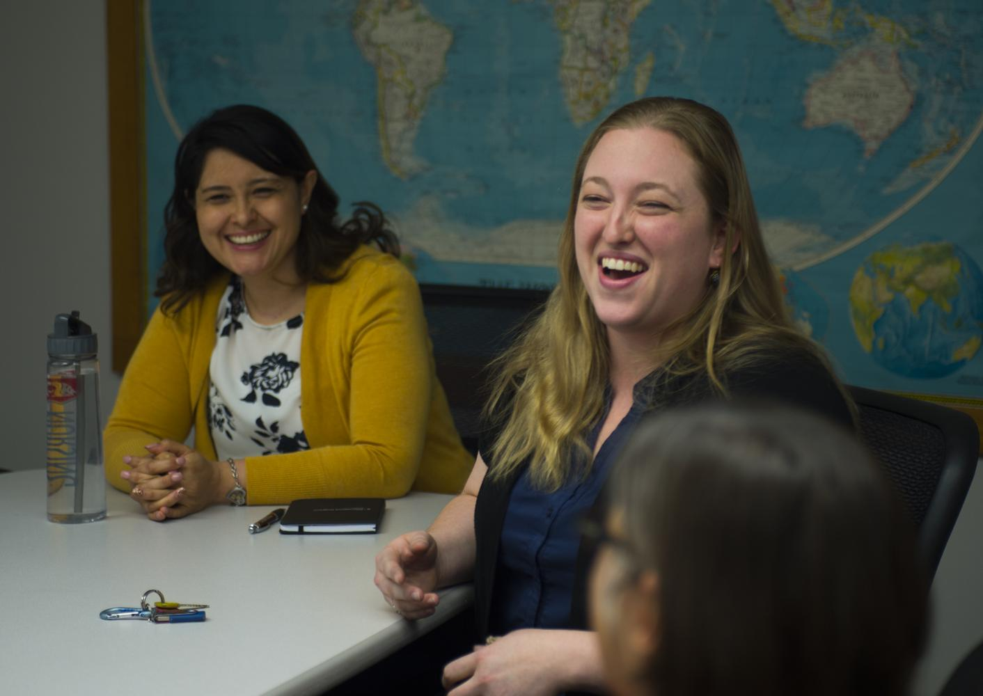 Mayra Villegas (left) and Anjie Bertramson talk about studying abroad.