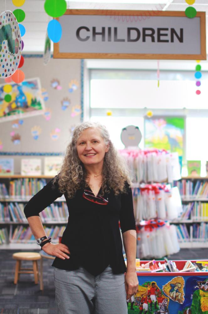 Librarian+Kathleen+Ahern+knows+middle+and+high+schoolers+that+came+to+parent-child+classes+when+she+began.