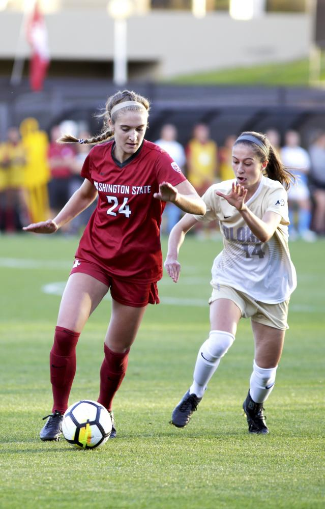 Junior midfielder Maegan ONeill dribbles the ball away from a player in a game against Colorado on Thursday.