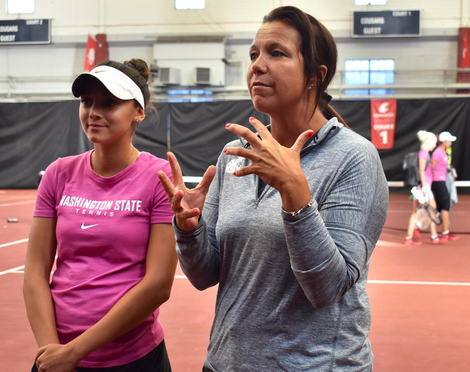 WSU women's tennis Head Coach Lisa Hart, right, discusses sophomore player Melisa Ates and her contributions to the team.