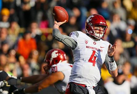 Redshirt senior quarterback Luke Falk snaps the ball during the 2016 game against Colorado on Nov. 19.  WSU lost 24-38.