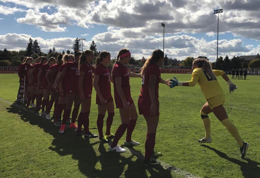 Redshirt junior goalkeeper Ella Dederick runs and high-fives her teammates before Sunday's game against Oregon State.