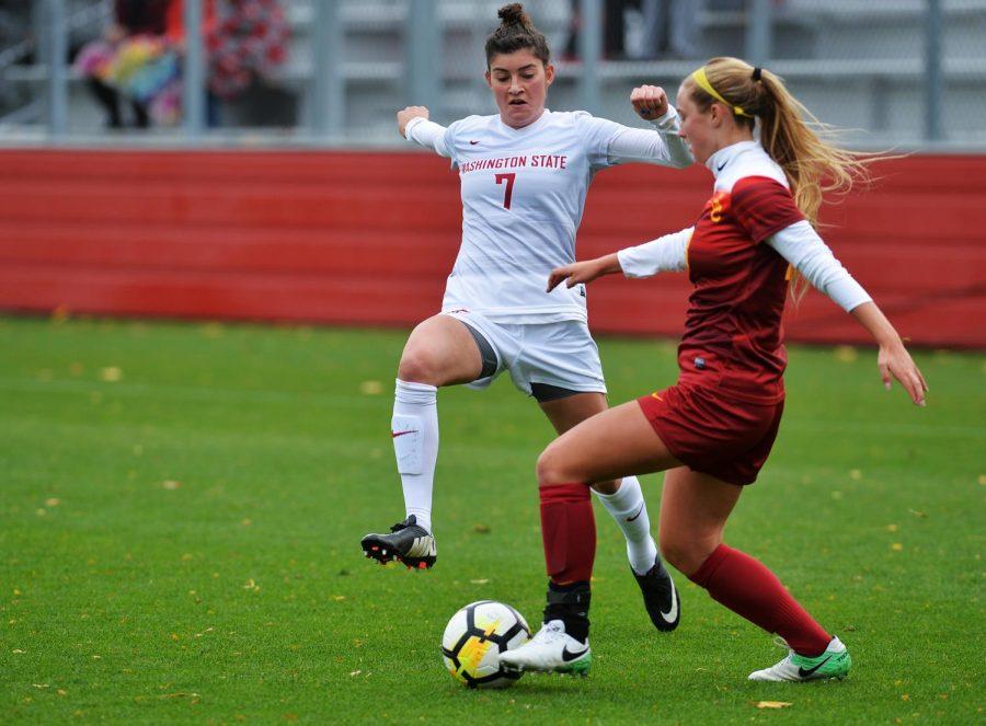 WSU senior midfielder Chelsea Harkins fights off USC freshman forward  Tara McKeown in Sunday's game against the Trojans.