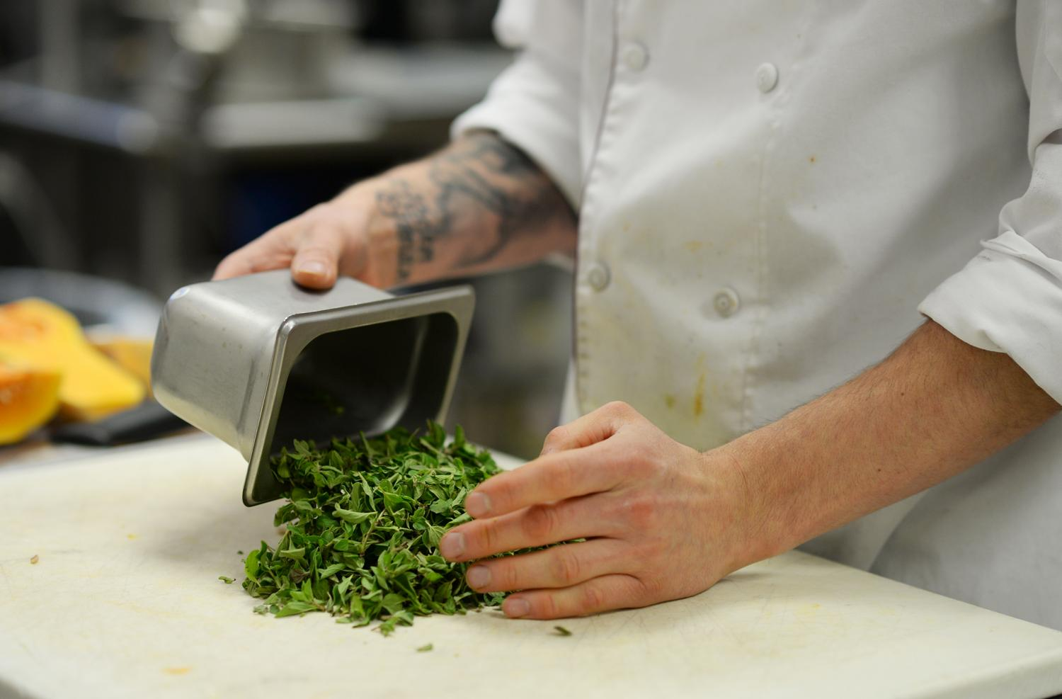Executive Chef Jason Butcherite prepares Hillside Cafe's menu of fresh, local ingredients. The quicker people consume food from when it is first harvested, the more nutrients they receive compared to long-traveled and less fresh foods.