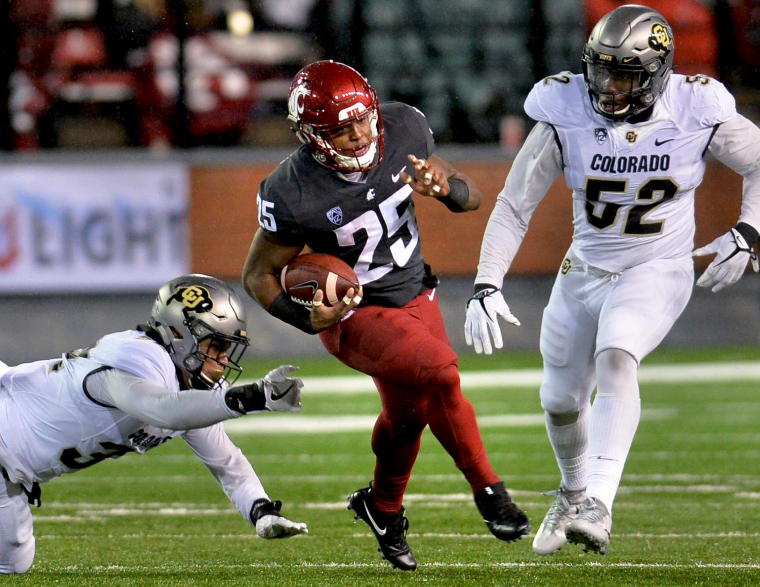 Redshirt senior running back Jamal Morrow dodges a Colorado defender during the Oct. 21 game against the Buffaloes.