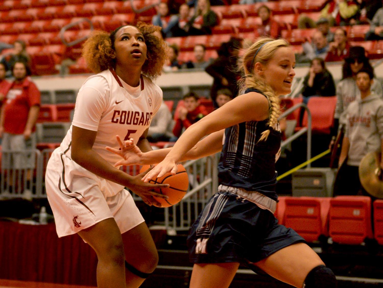 Sophomore forward Kayla Washington sheds her guard as she prepares for a shot during the WSU vs. Master's University game on Nov. 1.  WSU won 95-57.
