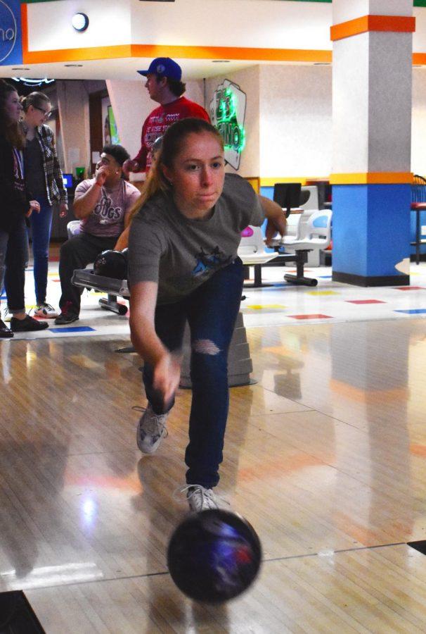 Junior Faith Julian takes her turn during the WSU Bowling Club meeting at Zeppoz.