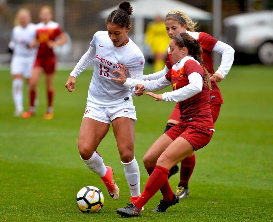 Freshman forward Elyse Bennett, left, works to dribble past USC's Julia Bingham during the Oct. 22 match.