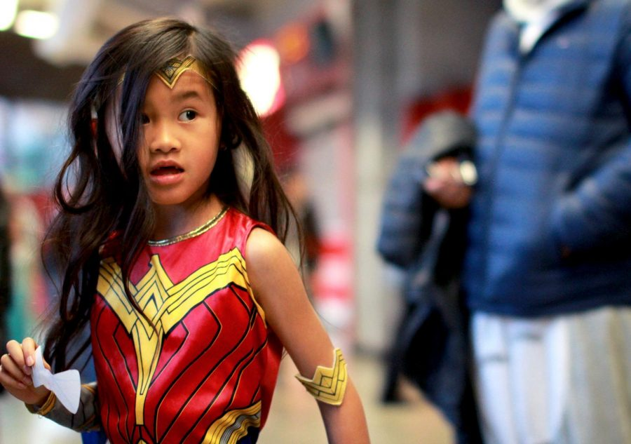 Evanee Hu, dressed as Wonder Woman, attends the fifth annual Washington State Kids' Carnival.