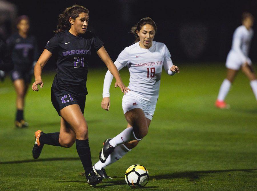WSU junior defender Maddy Haro battles freshman midfielder Olivia Van Der Jagt for the ball in a game against University of Washington on Friday.