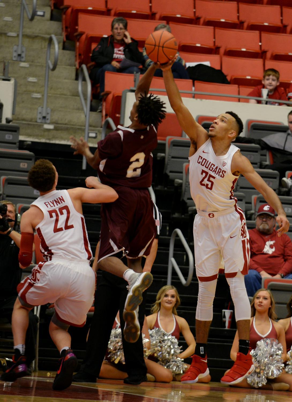 Redshirt freshman forward Arinze Chidom blocks Texas State University junior guard Derrick Bruce in Sunday's game. WSU won 86-84 in overtime.