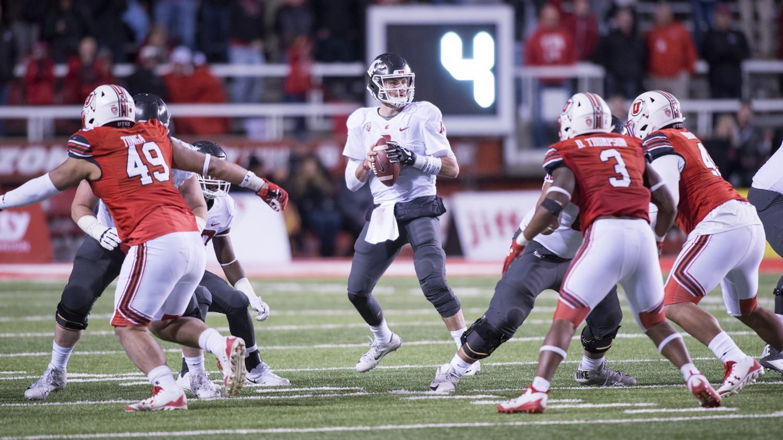 Redshirt senior quarterback Luke Falk prepares for a passing play in Saturday's game against University of Utah.