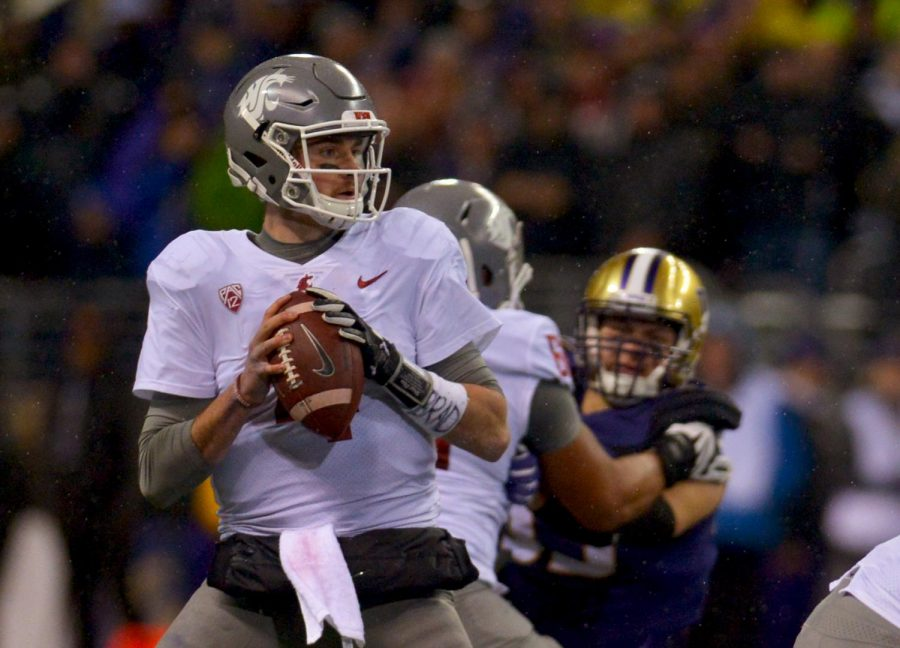 Then-redshirt+senior+quarterback+Luke+Falk+was+under+constant+pressure+from+the%0AUW+defense+during+the+2017+Apple+Cup+game+held+in+Husky+Stadium.