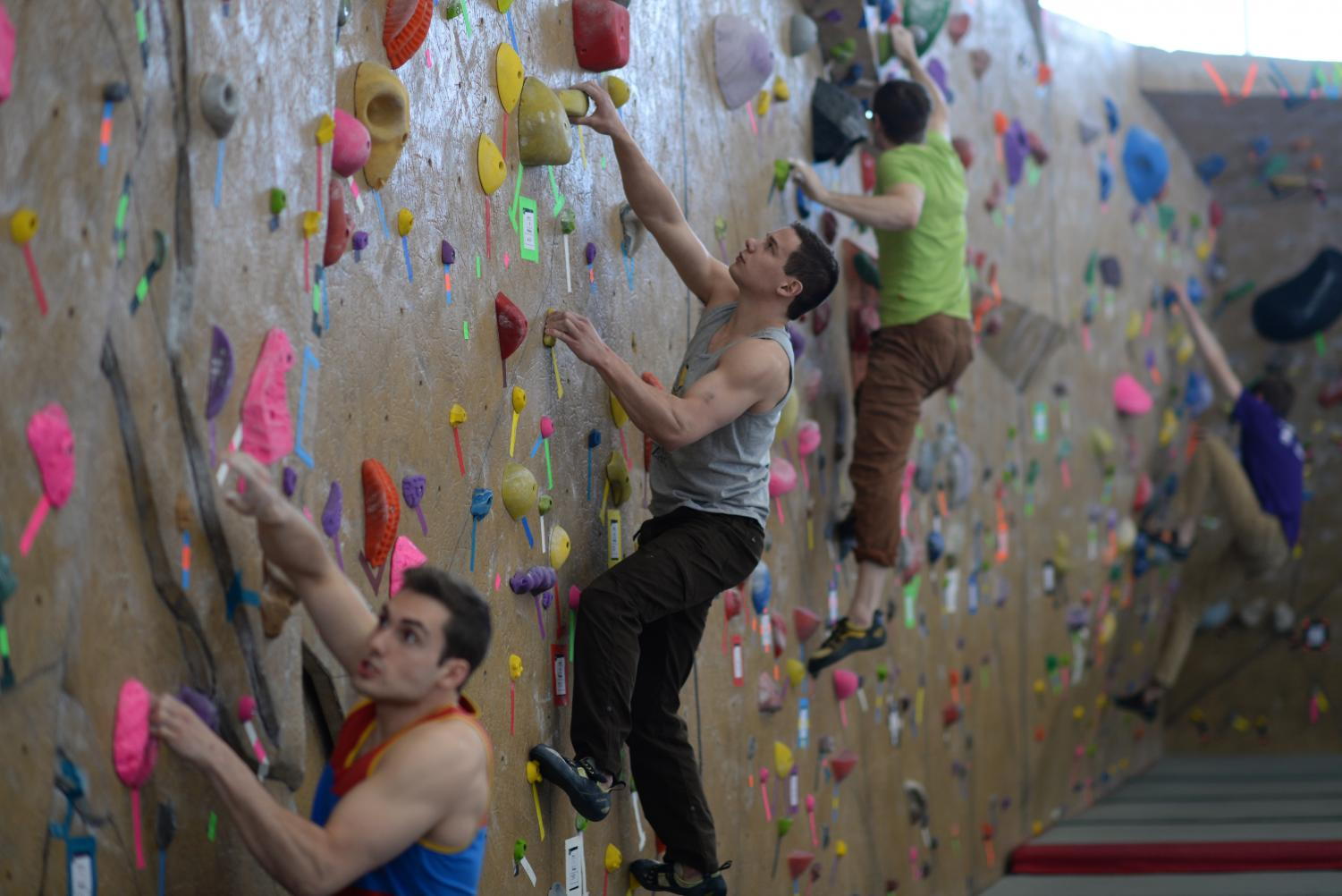 Contestants climb different routes during a bouldering competition at the UREC.