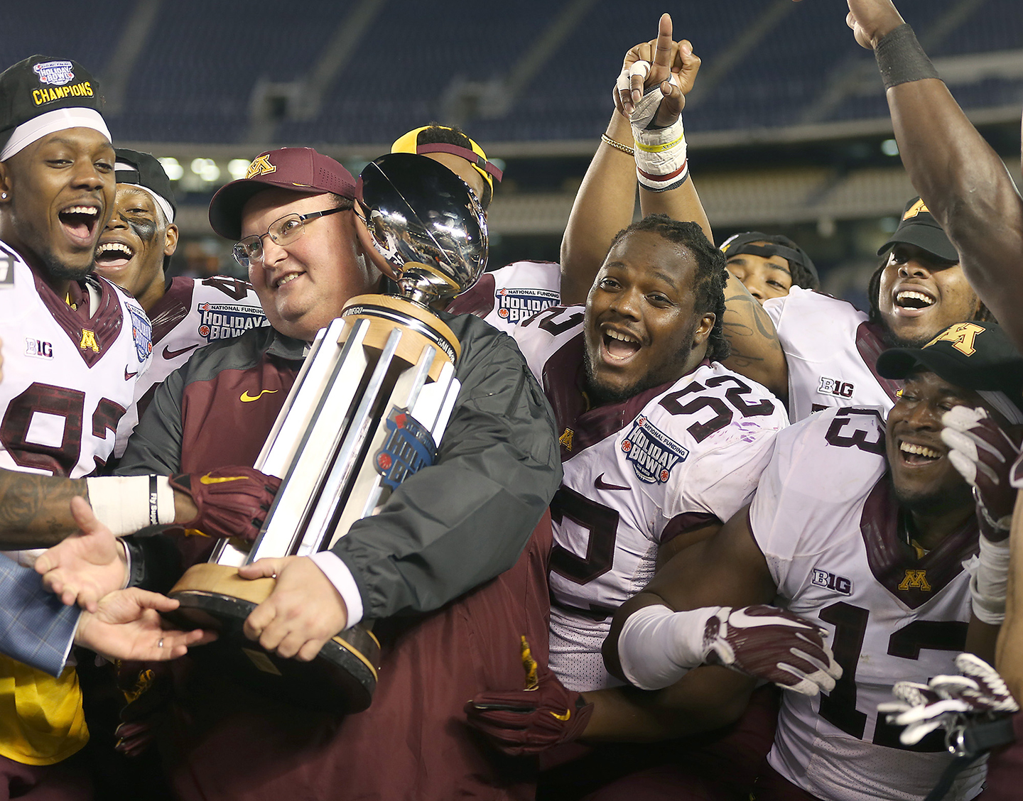 WSU defensive coordinator Tracy Claeys receives the Holiday Bowl trophy after his Minnesota team defeated the Cougars 17-12 on Dec. 27, 2016.