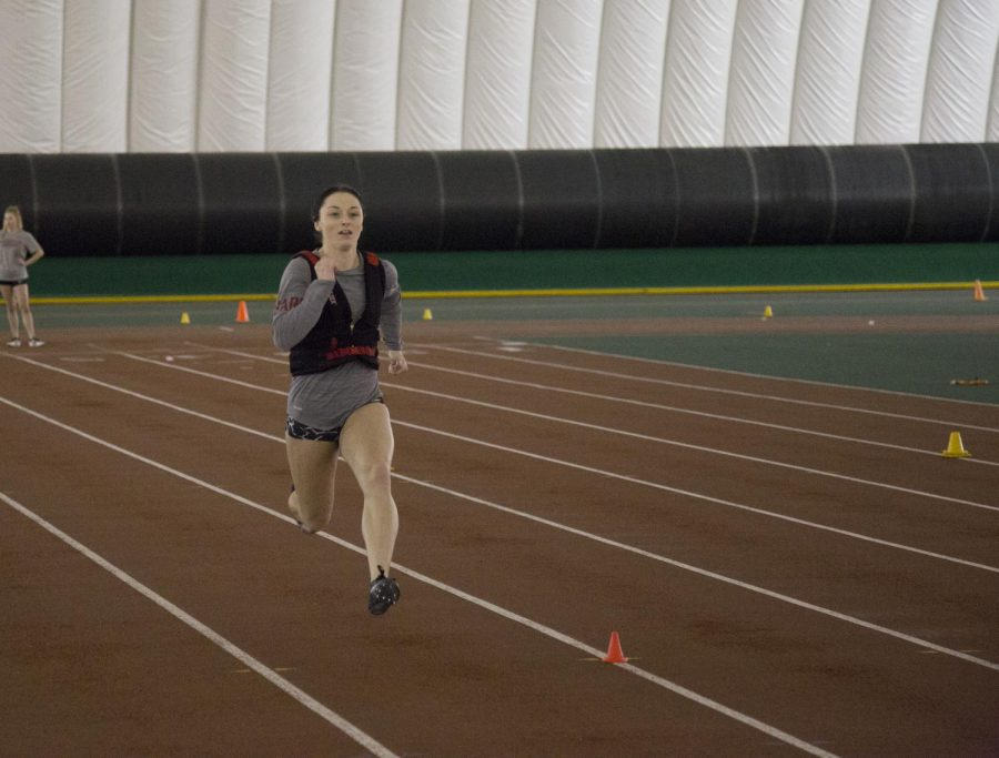 Junior+sprinter+Regyn+Gaffney+practices+with+her+fellow+track+teammates+at+the+Indoor+Practice+Facility+on+Jan.+9.