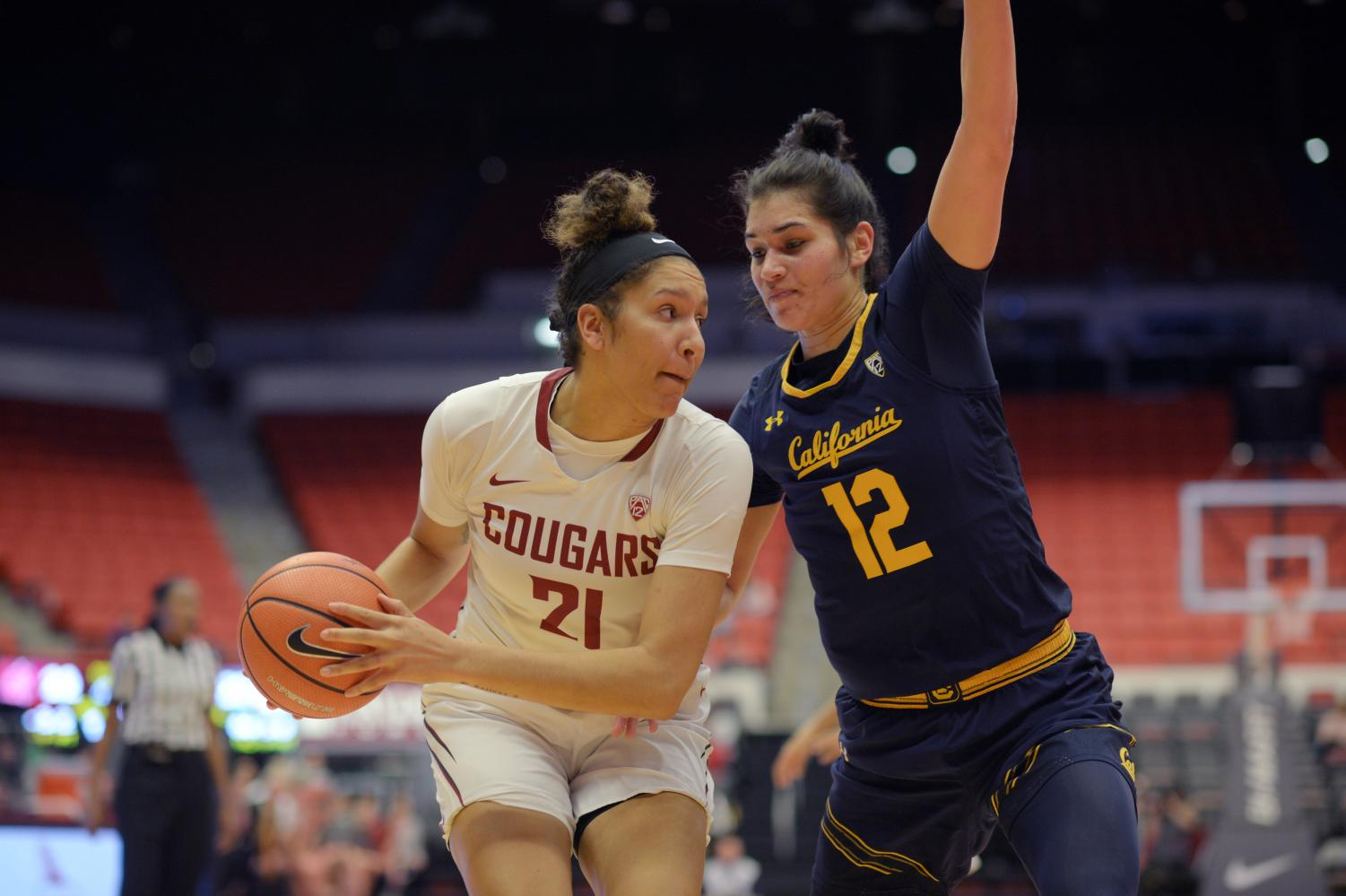 WSU forward Nike McClure defends the ball from Cal forward Penna Davidson Friday night in Beasley Coliseum.