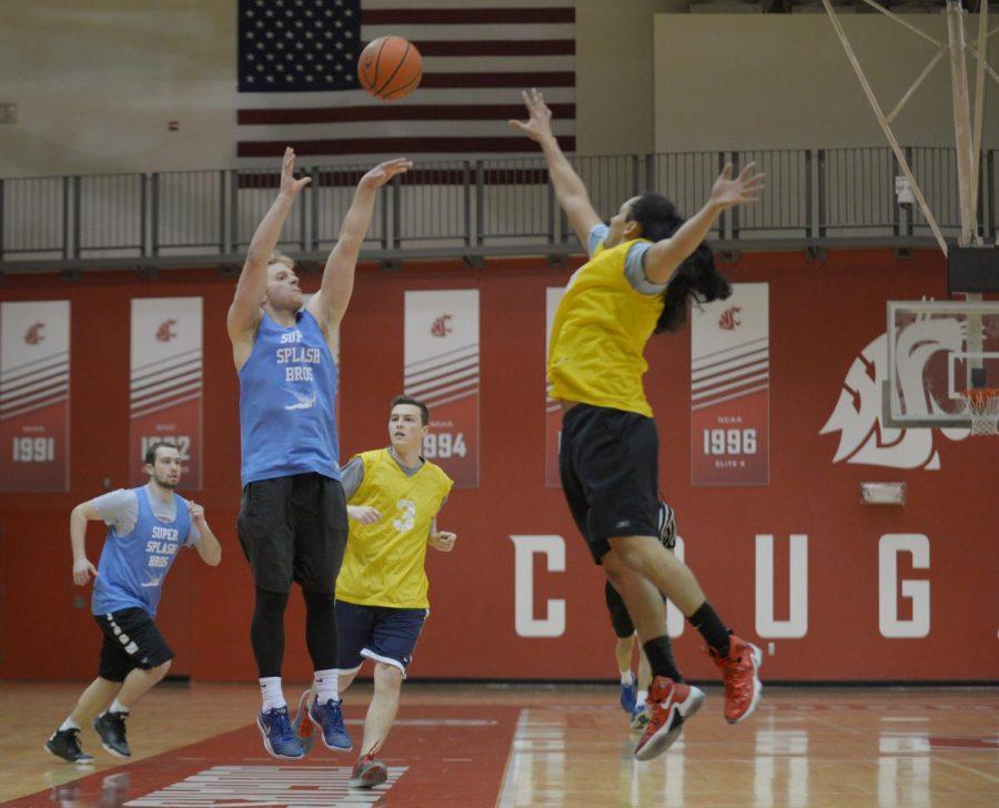 Junior Quinton McDaniels, left, shoots a jumper during an intramural basketball game at Bohler gymnasium.
