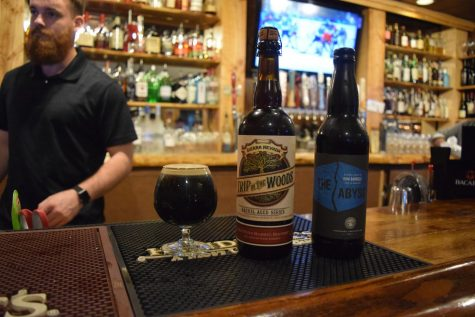 Jesse Rohr, bartender at Birch & Barley, displays some of their rare beers.  The event included beer from Sierra Nevada and Deschutes breweries.