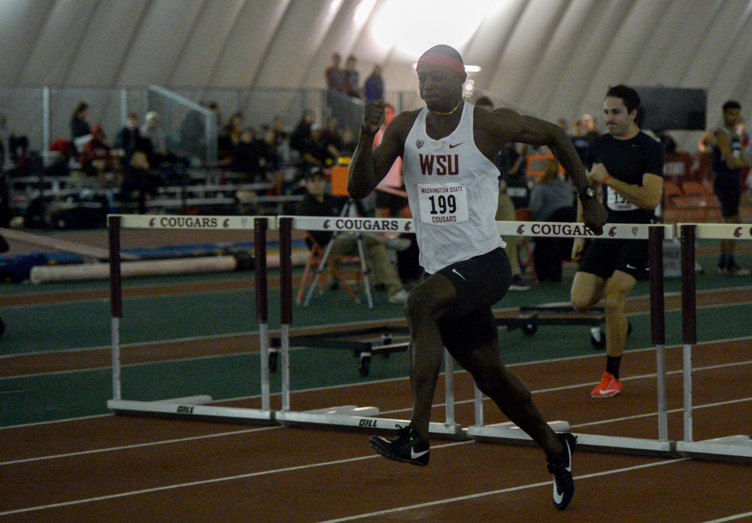 Abu Kamara competes in the 60 meter hurdles during the Cougar Indoor on Feb. 3.