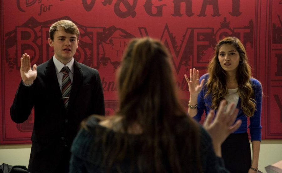 Newly elected freshman delegates Rhys Chapman, left, and Christalina Ramirez are sworn in Wednesday.