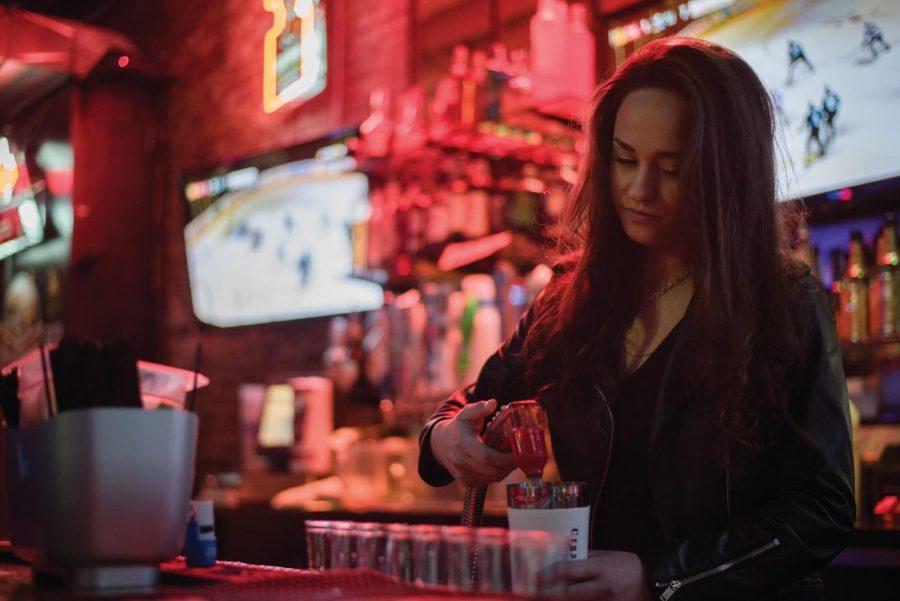 Stubblefields+bartender+Devinne+Schultz%2C+voted+Pullman%E2%80%99s+best%2C+prepares+drinks+for+her+coworkers+Thursday.