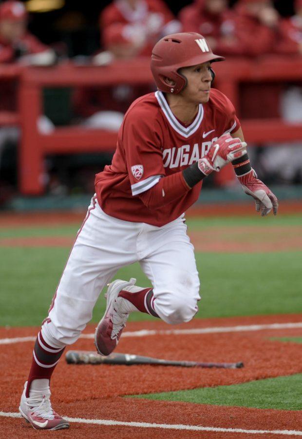 Then sophomore Andres Alvarez runs toward first base in a game against Utah Valley March 11, 2017 at Bailey–Brayton Field. Alvarez has a .355 batting average so far this season.