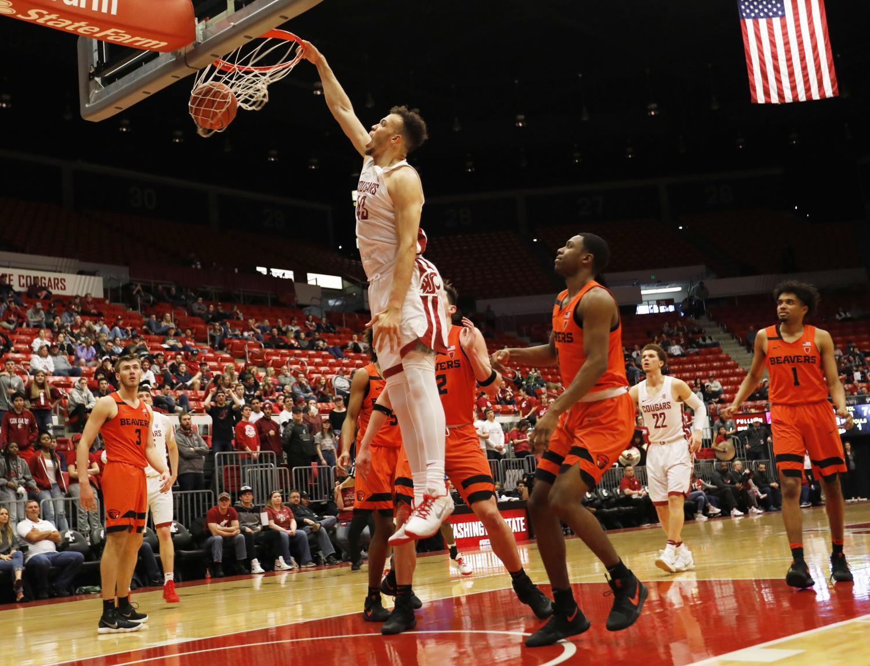 Redshirt senior forward Drick Bernstine slams in a basket against Oregon State in his final regular season game Saturday evening at Beasley Coliseum.