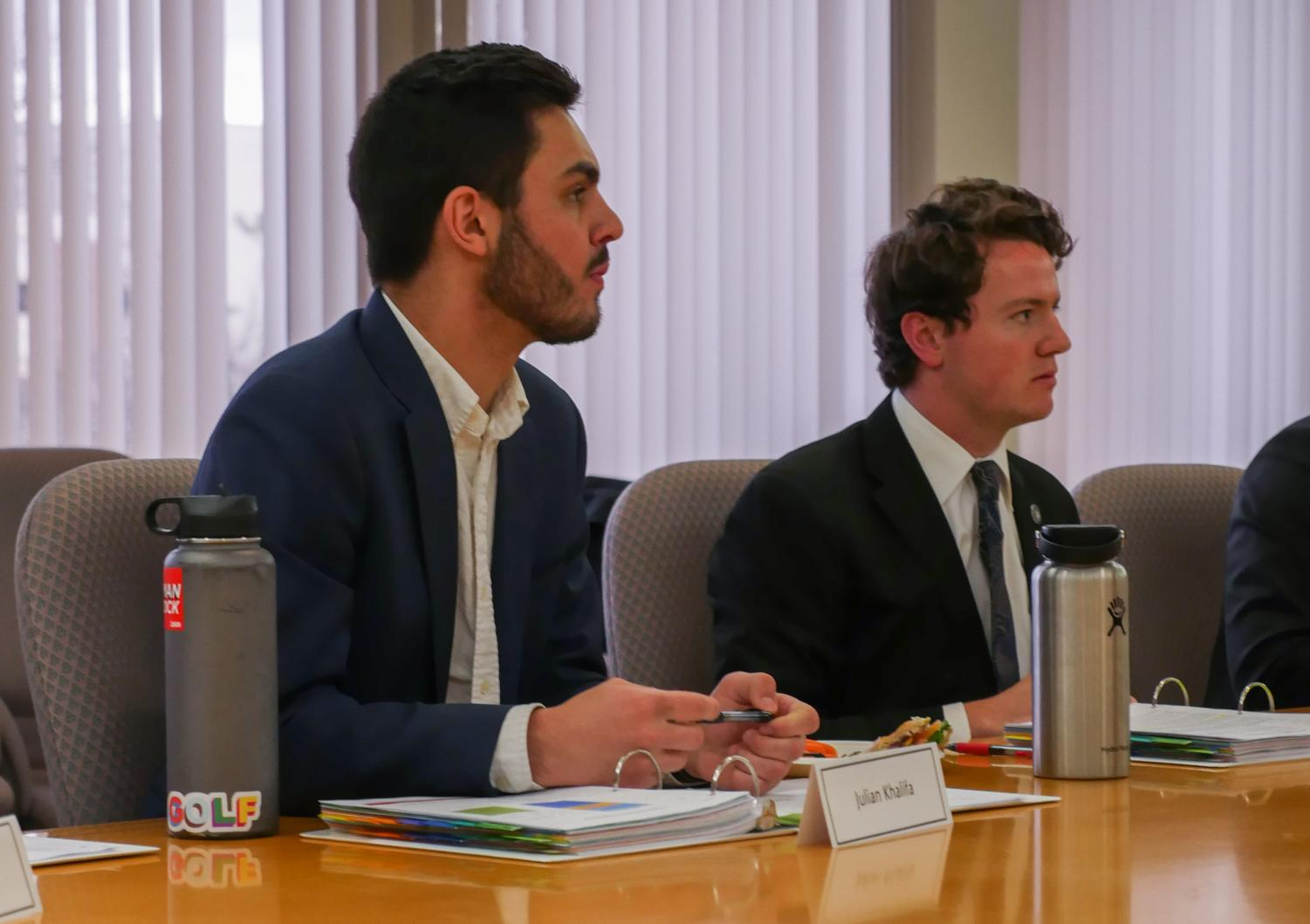 Julian Khalifa, undergraduate director of Students Book Corporation, left, and ASWSU Vice President Garrett Kalt listen to presentations during the Services and Activities meeting.