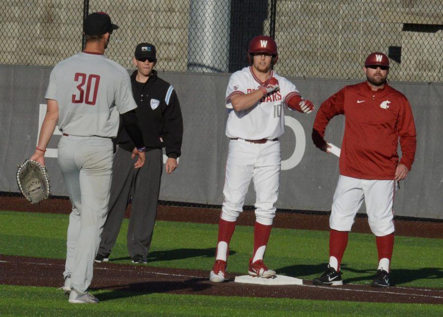 Senior first baseman James Rudkin waits on first base after batting in a single against Santa Clara University.