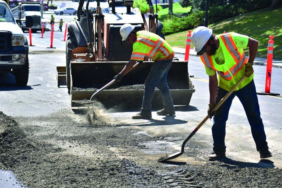 Workers+begin+repaving+Stadium+Way+near+the+Stephenson+Complex+on+Monday.