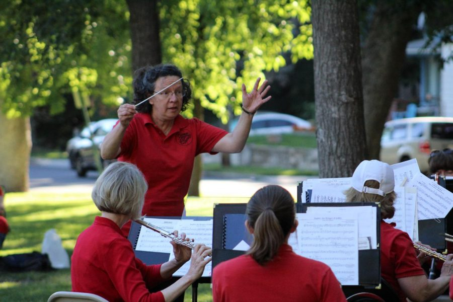 Denise Snider, music director of the Community Band of the Palouse, conducts during a piece at Reaney Park on Wednesday.