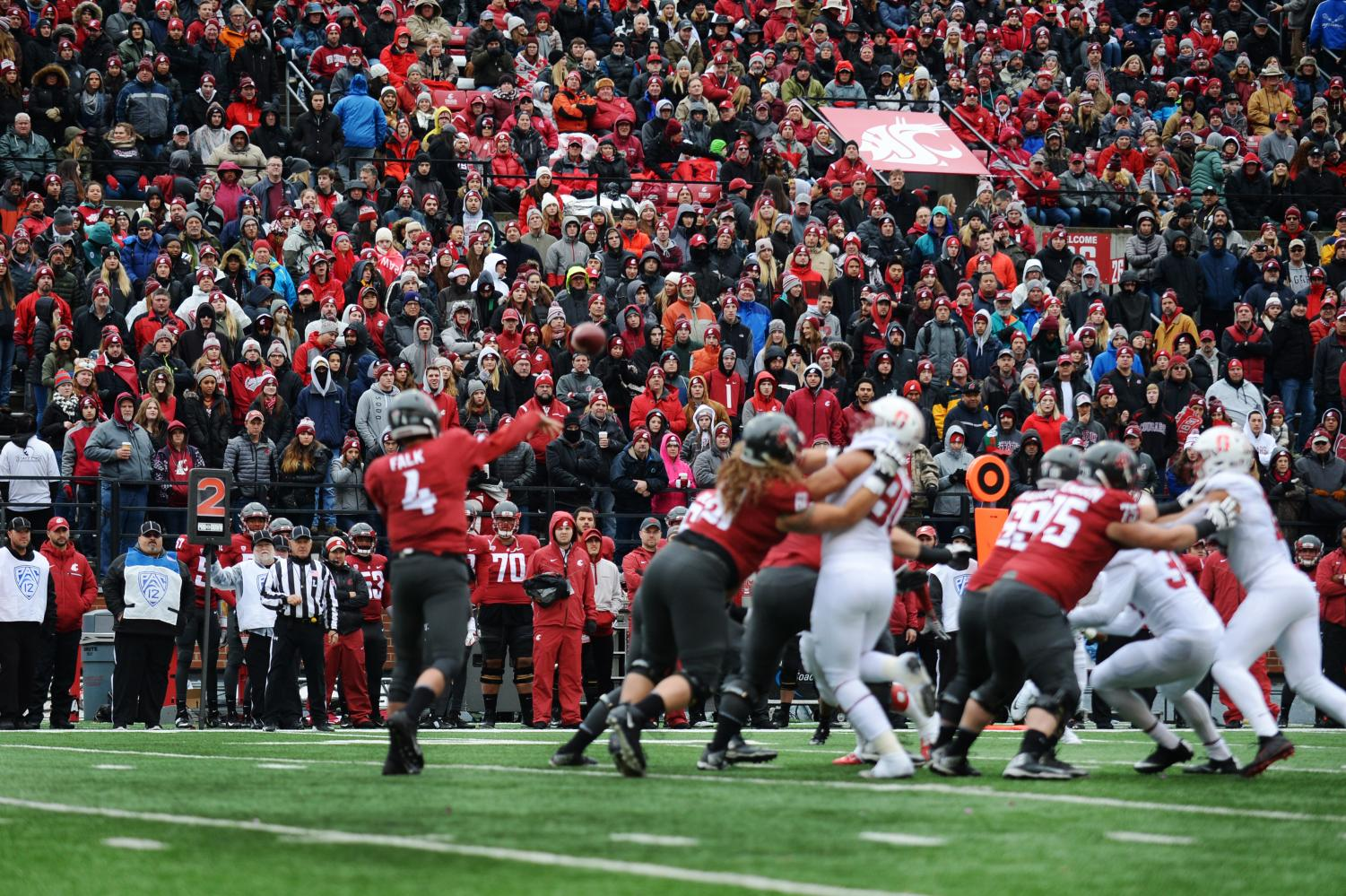 Then-redshirt senior quarterback Luke Falk throws a pass in Martin Stadium during a game against Stanford on Nov. 4, 2017
