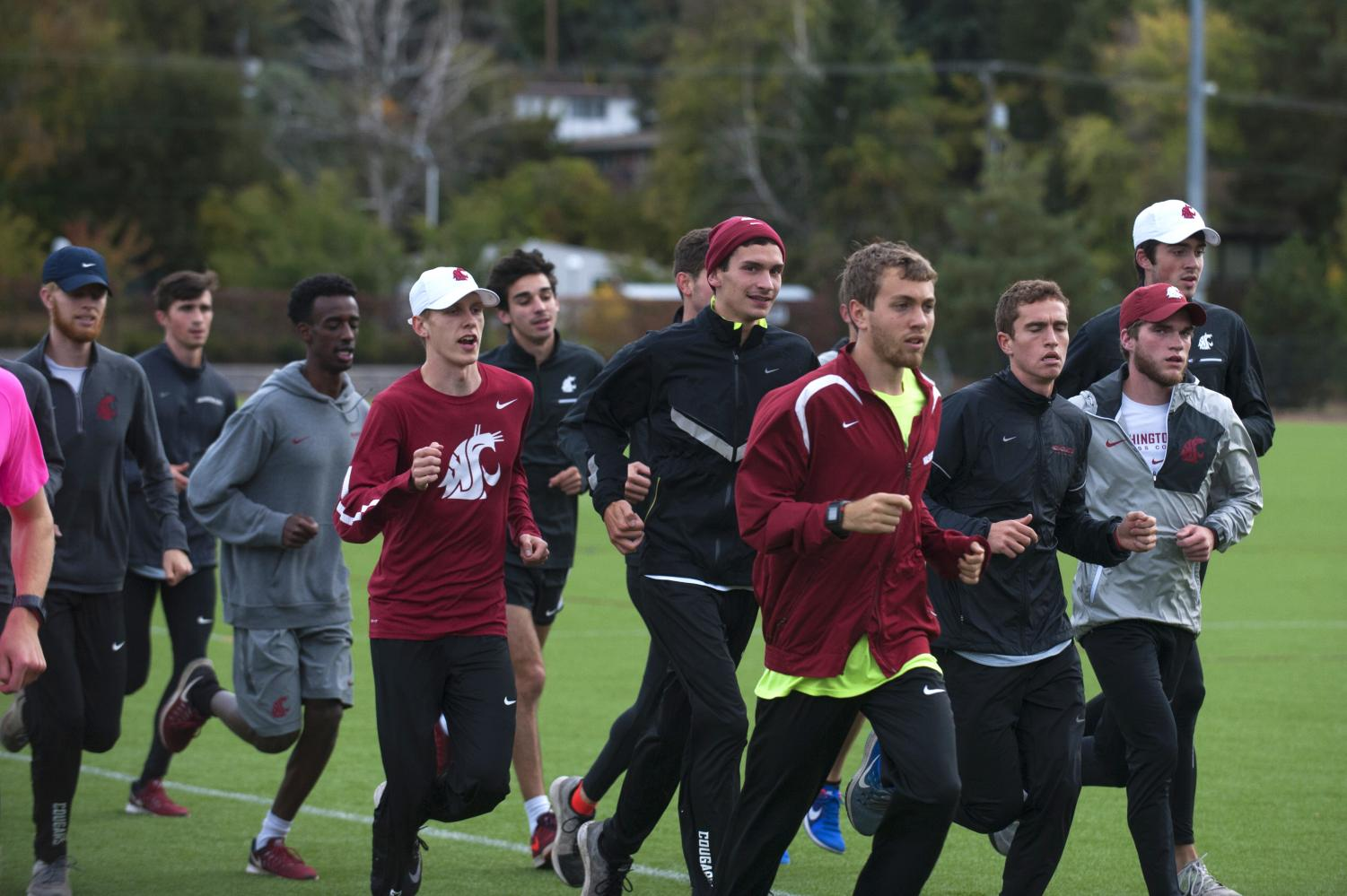 Members of the 2016 men's cross country team run during practice October 2016 at the Valley Road Playfields.