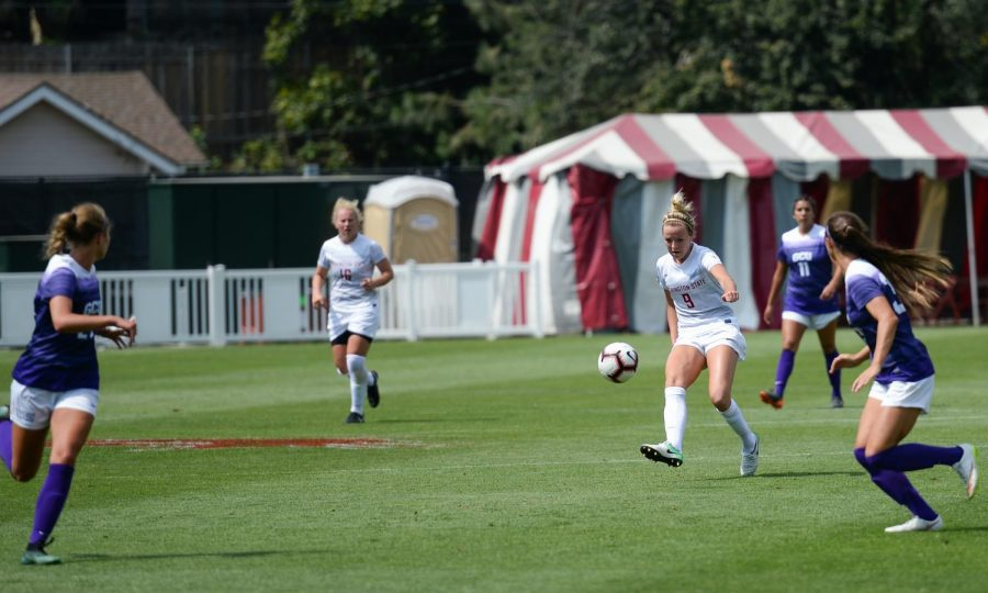 Sophomore+midfielder+Sydney+Pulver+kicks+the+ball+downfield+while+evading+multiple+GCU+players+during+a+match+Sunday+at+the+Lower+Soccer+Field.+Pulver+has+three+shots+on+goal+in+132+minutes+of+action+so+far+this+season.