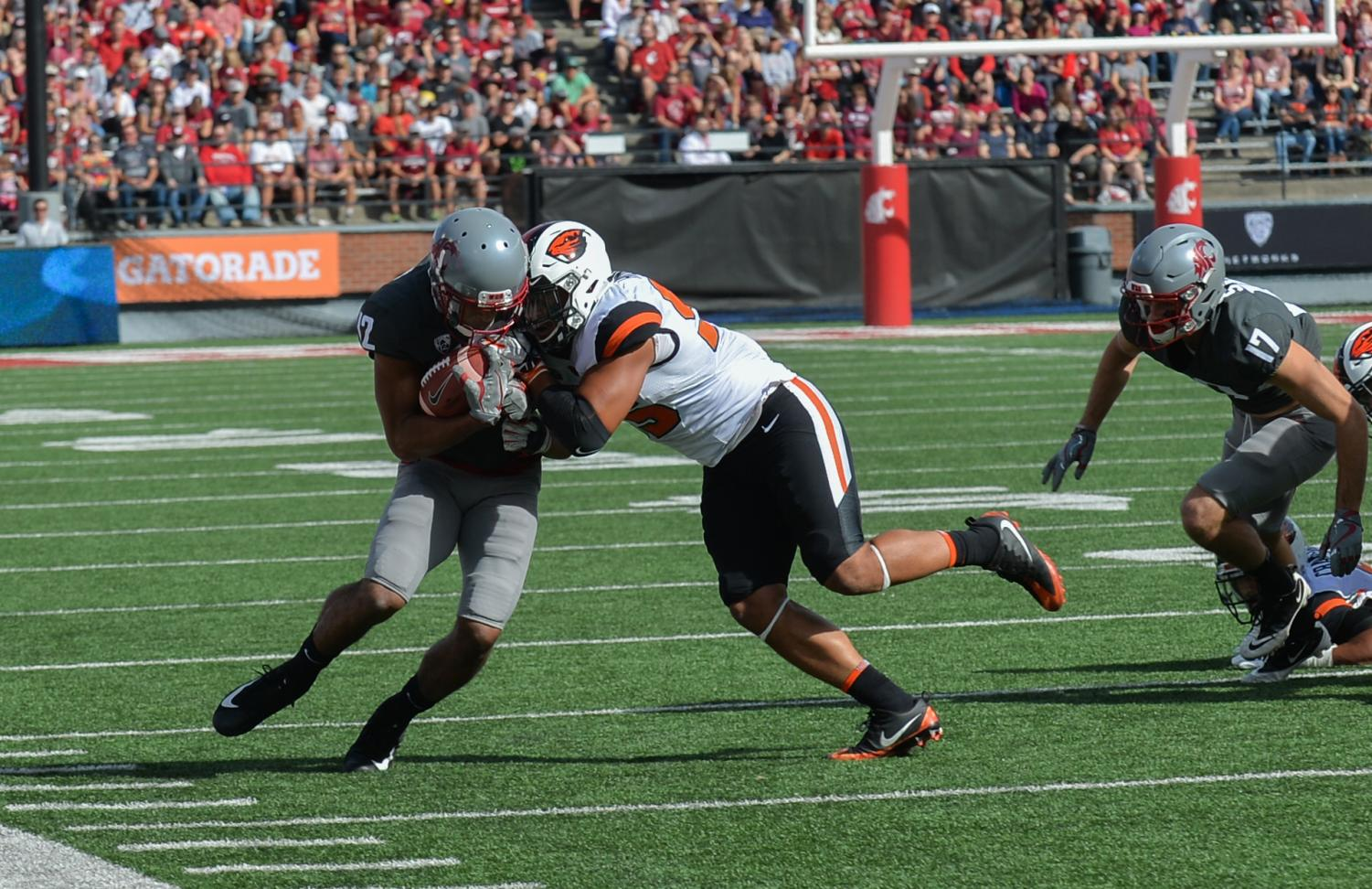 Then-sophomore wide receiver Dezmon Patmon atempts to break free from a defensive player during the game against OSU on Sept. 16 at Martin Stadium.