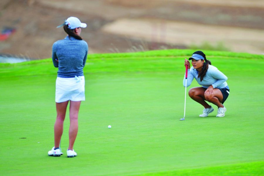 Then-senior Cherokee Kim scopes down her putt at the WSU women's golf Cougar Cup on Sept. 20.