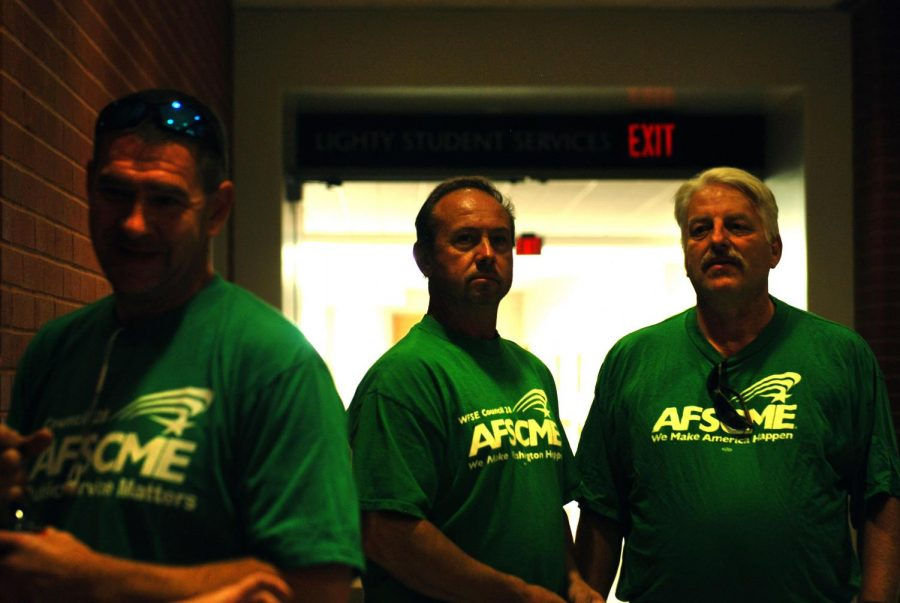 Food service supervisor Eric Needham, right, and other WSU Classified Staff lobby for a wage increase in their 2020-21 contract Monday at the Lighty French Administration Building.