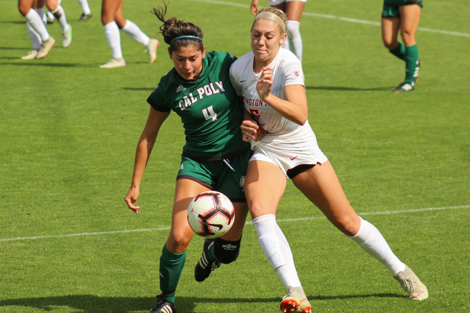 Junior forward Morgan Weaver battles against Cal Poly freshman defender Emily Talmi to take control of the ball in a game last Sunday at the Lower Soccer Field. The Cougars won 4-1.