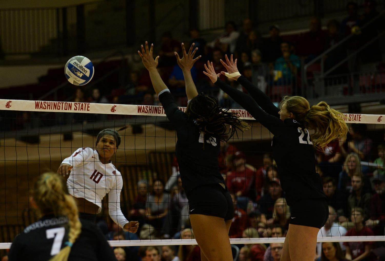 Then-junior outside hitter Taylor Mims attempts to spike the ball past a pair of Colorado defenders Oct. 6 at Bohler Gym.